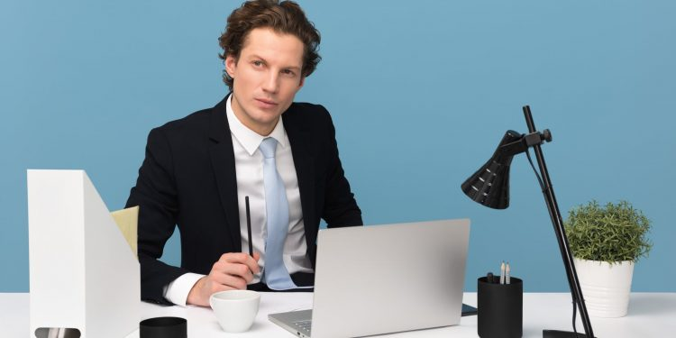 Man working from his laptop looking at LinkedIn